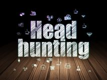 Business concept: Head Hunting in grunge dark room. Business concept: Glowing text Head Hunting,  Hand Drawn Business Icons in grunge dark room with Wooden Floor Royalty Free Stock Photography