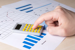 Business concept - graphs and charts analyzed by accountant Stock Images