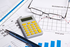 Business concept - graphs, charts and calculator Stock Image