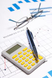 Business concept - graphs, charts, pen, glasses and calculator Royalty Free Stock Image