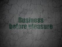 Business concept: Business Before pleasure on grunge wall background. Business concept: Green Business Before pleasure on grunge textured concrete wall Royalty Free Stock Photography