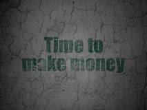 Business concept: Time to Make money on grunge wall background. Business concept: Green Time to Make money on grunge textured concrete wall background Stock Images
