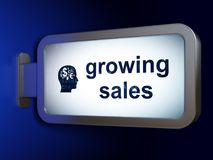 Business concept: Growing Sales and Head With Finance Symbol on billboard background Royalty Free Stock Photos