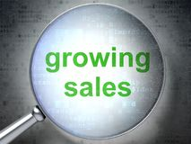 Business concept: Growing Sales with optical glass. Business concept: magnifying optical glass with words Growing Sales on digital background, 3D rendering Stock Images