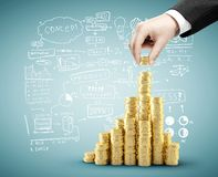 Business concept. Hand building coins chart, business concept Royalty Free Stock Photos