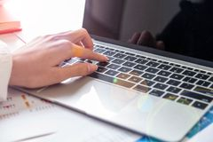Hand of business man place on laptop royalty free stock photo