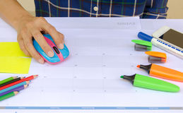 Business concept with hand clicking mouse with color pen, color Royalty Free Stock Photo