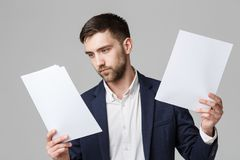 Business Concept - Handsome Business man serious working with annual report. White Background. Business Concept - Handsome Business man serious working with Royalty Free Stock Images