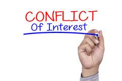 Business concept handwriting marker and write Conflict of Interest Stock Image
