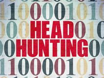 Business concept: Head Hunting on Digital Data Paper background. Business concept: Painted red text Head Hunting on Digital Data Paper background with Binary Stock Image