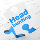 Business concept: Head Hunting on puzzle Stock Images
