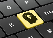 Business concept: Head With Light Bulb on computer keyboard background. Business concept: computer keyboard with Head With Light Bulb icon on enter button Stock Photography