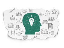 Business concept: Head With Light Bulb on Torn. Business concept: Painted green Head With Light Bulb icon on Torn Paper background with  Hand Drawn Business Royalty Free Stock Photography