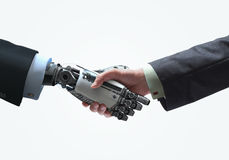 Business concept of Human and robot hands with handshake. Human and robot handshake Cybernetic Futuristic business relationship symbol Royalty Free Stock Photos