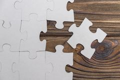 Business concept image for completing the final puzzle piece. stock photos