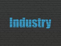 Business concept: Industry on wall background. Business concept: Painted blue text Industry on Black Brick wall background Stock Image