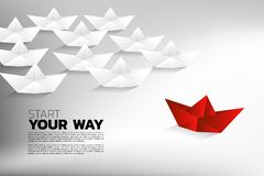 Red origami paper ship move to difference direction from group of white. vector illustration