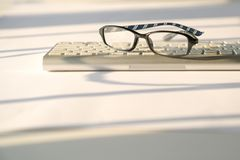 Business concept: keyboard and reading glasses on white background royalty free stock photos
