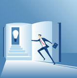 Business concept knowledge and idea. Business concept of knowledge and a new idea, the employee runs up the stairs in the book to find an idea Royalty Free Stock Image