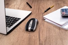 Laptop, blank notepad pen and mouse. Business concept - laptop, blank notepad, pen and mouse Royalty Free Stock Photography