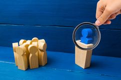 Business concept of leader and leadership qualities, crowd management, political debate and elections. Magnifying glass is looking. At the leader from the royalty free stock images