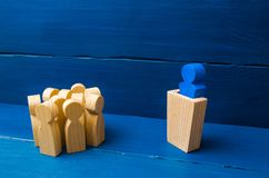 Business concept of leader and leadership qualities, crowd management, political debate and elections. Business management. The le. Ader from the rostrum speaks stock photos