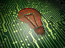 Business concept: Light Bulb on circuit board Royalty Free Stock Images
