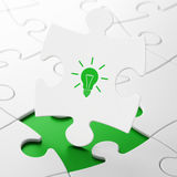 Business concept: Light Bulb on puzzle background Stock Photography