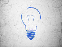 Business concept: Light Bulb on wall background. Business concept: Blue Light Bulb on textured concrete wall background, 3d render Stock Photography
