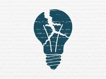 Business concept: Light Bulb on wall background. Business concept: Painted blue Light Bulb icon on White Brick wall background Stock Images