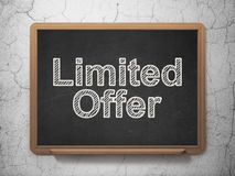 Business concept: Limited Offer on chalkboard. Business concept: text Limited Offer on Black chalkboard on grunge wall background, 3d render Stock Image