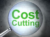 Business concept: Cost Cutting with optical glass royalty free stock photography