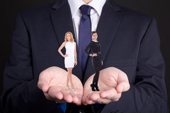 Business concept - man holding two women in his hands Stock Photos