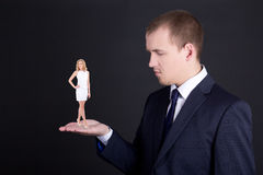 Business concept - man holding woman on his hand Stock Image