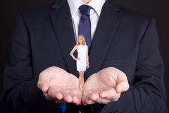 Business concept - man holding woman on his hands Stock Photo
