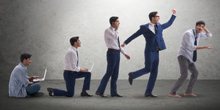The business concept with man progressing through stages Royalty Free Stock Image