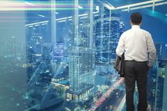 Business concept. Business man standing and looking forward to business district city center outside. Business concept. Business man backside standing and royalty free stock images