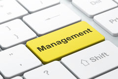 Business concept: Management on computer keyboard background Stock Photos