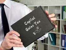 Business concept meaning Capital Gains Tax with inscription on the piece of paper