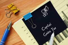 Business concept meaning Capital Gains Tax with inscription on the sheet