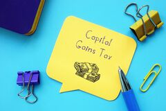 Business concept meaning Capital Gains Tax with sign on the piece of paper