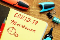Free Business Concept Meaning Covid-19 Moratorium With Phrase On The Piece Of Paper Stock Images - 182694174