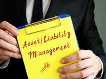 Business concept meaning Examples of Asset/Liability Management with sign on the piece of paper