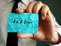 Business concept meaning FHA Loan with sign on the page