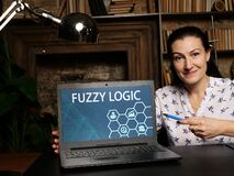 Business concept meaning FUZZY LOGIC with inscription on the laptop. A form of many-valued logic in which the truth values of