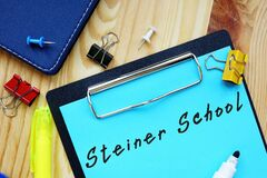 Business concept meaning Steiner School with phrase on the piece of paper