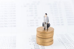 Business concept with miniature people workers on money coin Royalty Free Stock Photo