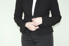 Business concept. Modesty and indecision. Business woman in a black jacket. Photo for your design Stock Photo
