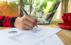 Business concept with money and documents graph, report finance,. Businessman writing graph Stock Photos
