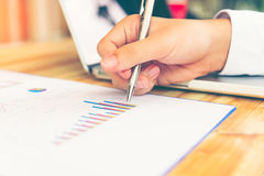 Business concept with money and documents graph, report finance,. Businessman writing graph Royalty Free Stock Images